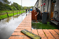 Flooding effected the villages of Aberdulais and Tonna in the Neath Valley after Storm Callum brought heavy rain and wind to the area cuasing the River Neath to reach bursting point.L<br /> Luke Griffiths sweeps away water from his family home at Canal Side, Tonna, Neath. . Saturday 13 October 2018