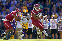NWA Democrat-Gazette/BEN GOFF @NWABENGOFF<br /> Devwah Whaley, Arkansas running back, runs the ball as Jeremy Patton, Arkansas tight end, blocks Corey Thompson, LSU defender, in the second quarter Saturday, Nov. 11, 2017 at Tiger Stadium in Baton Rouge, La.