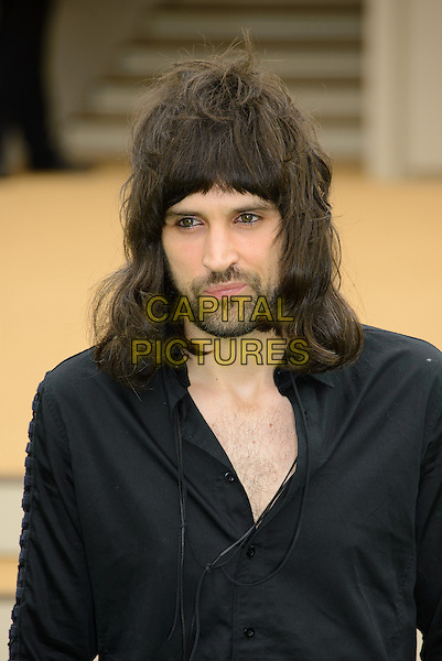 Sergio Lorenzo &quot;Serge&quot; Pizzorno of Kasabian<br /> Burberry Prorsum Menswear Spring/Summer 2014 Collection at Perks Field, Kensington Gardens - Arrivals, London, England.<br /> 18th June 2013 <br /> headshot portrait black shirt beard stubble facial hair<br /> CAP/CJ<br /> &copy;Chris Joseph/Capital Pictures