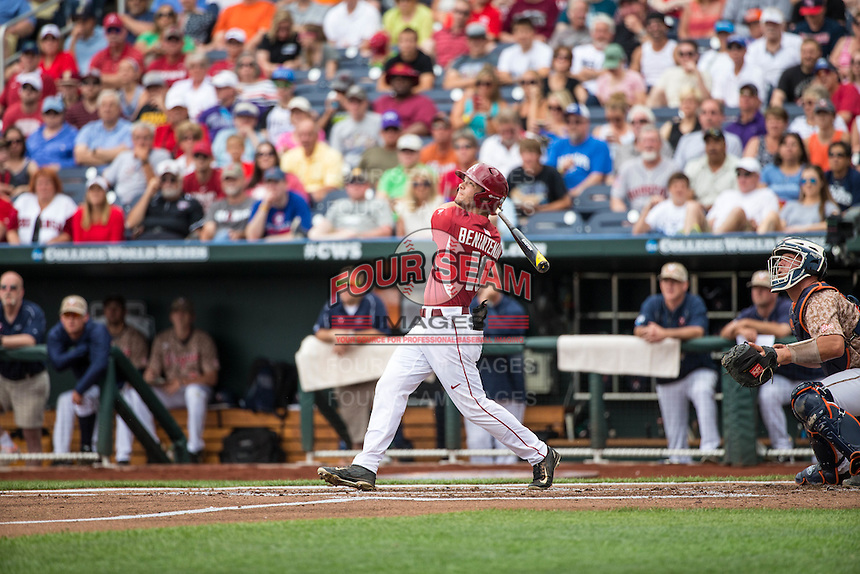Andrew Benintendi (16) of the Arkansas Razorbacks bats during a game between the Virginia Cavaliers and Arkansas Razorbacks at TD Ameritrade Park on June 13, 2015 in Omaha, Nebraska. (Brace Hemmelgarn/Four Seam Images)