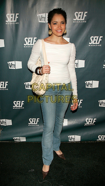 "SUZIE CASTILLO.At SELF Magazine and VH1 5th Annual ""Most Wanted Bodies"" event at Stereo, New York, NY, USA..March 15th, 2006.Photo: Jackson Lee/Admedia/Capital Pictures.Ref: JL/ADM.full length white top jeans denim purse bag.www.capitalpictures.com.sales@capitalpictures.com.© Capital Pictures."
