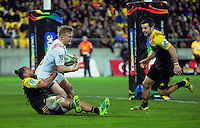 Matt Proctor sacks Damien McKenzie behind his own line during the Super Rugby semifinal match between the Hurricanes and Chiefs at Westpac Stadium, Wellington, New Zealand on Saturday, 30 July 2016. Photo: Dave Lintott / lintottphoto.co.nz