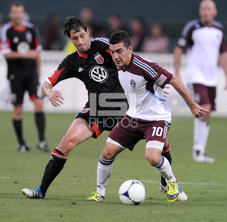 Colorado Rapids midfielder Martin Rivero (10) shields the ball from D.C. United midfielder Branko Boskovic  D.C. United defeated the Colorado Rapids 2-0 at RFK Stadium, Wednesday May 16, 2012.