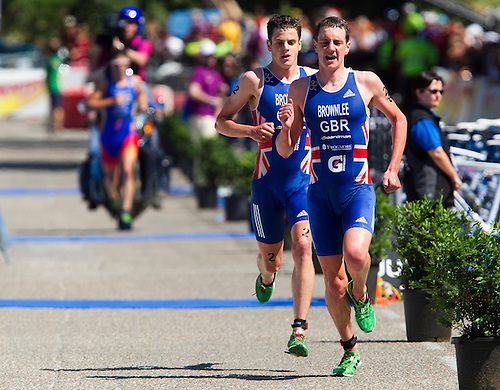 04 JUN 2011 - MADRID, ESP - Alistair Brownlee (right) builds up a lead with brother Jonathan Brownlee, over series leader Javier Gomez, on the run at the Madrid round of triathlon's ITU World Championship Series (PHOTO (C) NIGEL FARROW)