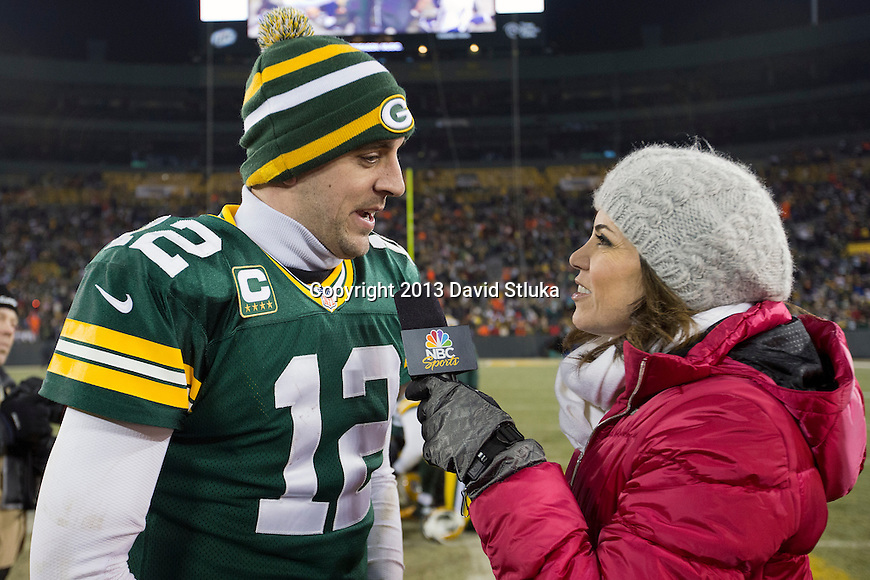 NBC Sports sideline reporter Michelle Tofoya interviews Green Bay Packers quarterback Aaron Rodgers (12) after an NFL wild card playoff football game against the Minnesota Vikings Saturday, January 5, 2013, in Green Bay, Wis. The Packers won 24-10. (AP Photo/David Stluka)