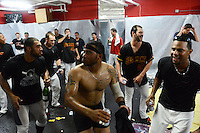 Rochester Red Wings players including Jermaine Mitchell, Eric Farris (no shirt), Aaron Thompson (27) and Aaron Hicks dance as the team celebrates in the locker room after defeating the Scranton Wilkes Barre RailRiders on September 2, 2013 at Frontier Field in Rochester, New York to clinch the International League Wild Card Playoff spot.  (Mike Janes/Four Seam Images)
