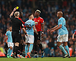 Nicolas Otamendi of Manchester City confronts Paul Pogba of Manchester United as Pogba receives a yellow card during the premier league match at the Etihad Stadium, Manchester. Picture date 7th April 2018. Picture credit should read: Simon Bellis/Sportimage