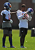 Odell Beckham, Jr. #13, New York Giants wide receiver, pats Victor Cruz #80 on the shoulder during practice at Quest Diagnostics Training Center in East Rutherford, NJ on Monday, Aug. 29, 2016.