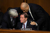 Senators, Sheldon Whitehouse, Democrat of Rhode Island, left, Richard Blumenthal, Democrat of Connecticut, center, and Cory Booker, Democrat of New Jersey, right, speak as Democrats and Republicans debate during a hearing before the United States Senate Judiciary Committee to consider the nomination of Judge Brett Kavanaugh to be an Associate Justice of the US Supreme Court to replace the retiring Justice Anthony Kennedy on Capitol Hill in Washington, DC on Tuesday, September 4, 2018.Credit: Alex Edelman / CNP