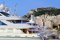Marina yachts and downtown Monte Carlo at night, Monaco