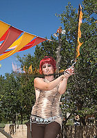 The Renaissance Fair is held each September at the historic museum of El Rancho de Las Golondrinas near Santa Fe and features dancers, knights, acrobats and many other performers celebrating the culture and lifestyle of the Medieval Middle Ages. Angela Keen performs as Sanke theFire Dancer.