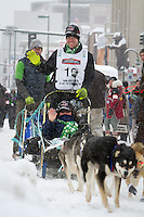 Travis Cooper leaves the 2011 Iditarod ceremonial start line in downtown Anchorage, during the 2012 Iditarod..Jim R. Kohl/Iditarodphotos.com