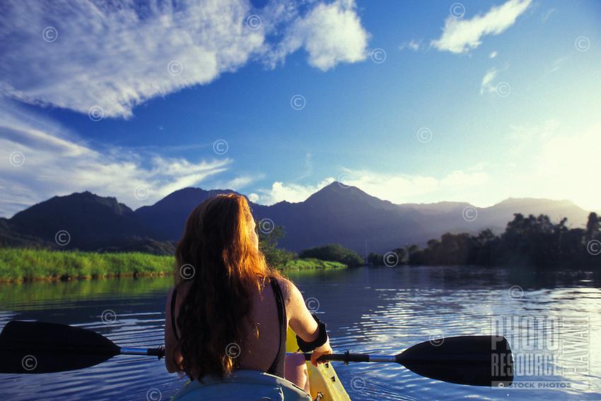 Woman kayaking on Hanalei River, Kauai