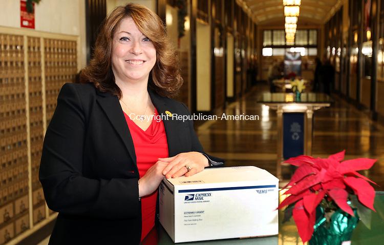 WATERBURY CT. 04 December 2015-120415SV04-Lisa King, Waterbury's first female postmaster, stands in the lobby of the post office on Grand Street in Waterbury Friday.<br /> Steven Valenti Republican-American
