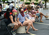 Janine Parry (center) of Fayetteville watches Saturday, June 20, 2020, as Art Ventures artists work on a mural during the Fayetteville in Living Color event in the parking lot of St. Paul's Episcopal Church in Fayetteville. The event was held to register residents to vote, to support the Black Lives Matter movement and to foster community unity. Visit nwaonline.com/200621Daily/ for today's photo gallery.<br /> (NWA Democrat-Gazette/Andy Shupe)