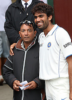 India's Munaf Patel with Wellington businessman Monty Patel, owner of the Tulsi Restaurant chain, during day four of the 3rd test between the New Zealand Black Caps and India at Allied Prime Basin Reserve, Wellington, New Zealand on Monday, 6 April 2009. Photo: Dave Lintott / lintottphoto.co.nz.