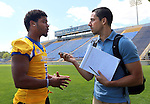 BROOKINGS, SD - AUGUST 11: Melvin Taveras #1 of South Dakota State University football talks to Terry Vandrovec Monday afternoon at the Jacks Media Day in Brookings. (Photo by Dave Eggen/Inertia)