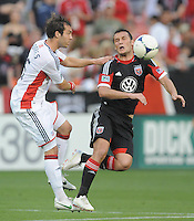 D.C. United forward Hamdi Salihi (9) goes against New England Revolution defender A.J. Soares (5)  D.C. United defeated The New England Revolution 3-2 at RFK Stadium, Saturday May 26, 2012.
