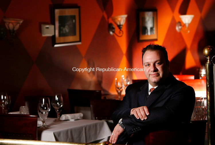 WATERBURY, CT, 02/04/08- 020409BZ08- Vasilias Kaloidis, owner/partner, poses in the dining room of Vintage Restaurant on Bank Street in Waterbury Wednesday. <br /> Jamison C. Bazinet Republican-American