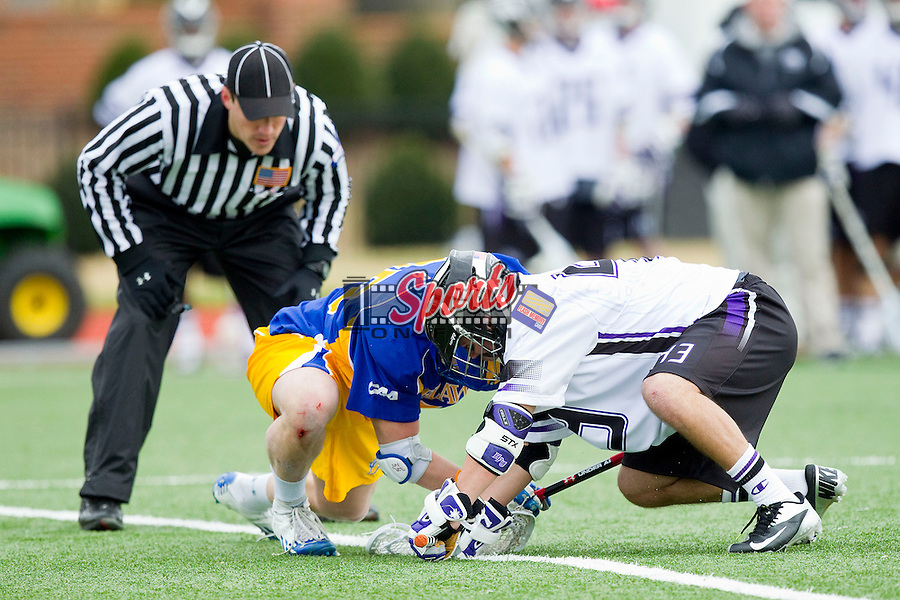 Chris Davila (43) of the High Point Panthers battles for a face-off against Tyler Barbarich (25) of the Delaware Blue Hens at Vert Track, Soccer & Lacrosse Stadium on February 2, 2013 in High Point, North Carolina.  The Blue Hens defeated the Panthers 12-10.   (Brian Westerholt/Sports On Film)