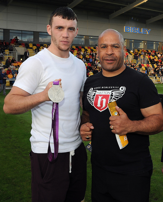 Olympic Silver medalist Fred Evans shows the Newport crowd his Silver Medal with Coach Tony Borg..Newport County V Hereford United - Blue square Premier division - Tuesday 28th August 2012 - Football  - Rodney Parade - Newport..