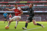 Arsenal's Sokratis Papastathopoulos shields the ball from Burnley's Jeff Hendrick<br /> <br /> Photographer David Shipman/CameraSport<br /> <br /> The Premier League - Arsenal v Burnley - Saturday 22nd December 2018 - The Emirates - London<br /> <br /> World Copyright © 2018 CameraSport. All rights reserved. 43 Linden Ave. Countesthorpe. Leicester. England. LE8 5PG - Tel: +44 (0) 116 277 4147 - admin@camerasport.com - www.camerasport.com