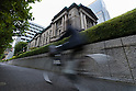 A man on a bicycle rides past the Bank of Japan on September 21, 2016, Tokyo, Japan. The Bank of Japan (BOJ) announced it would modify its monetary policy framework on Wednesday by expanding the monetary base until inflation is stable above the 2% target it set more than three years ago. It also said that it would aim to keep yields on 10-year government bonds at current levels around zero percent. In reaction to Japan's central bank decision the Nikkei 225 Stock Average closed up 1.91 percent to 16,807.62. (Photo by Rodrigo Reyes Marin/AFLO)