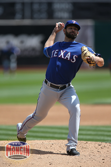 OAKLAND, CA - APRIL 9:  Nick Martinez #22 of the Texas Rangers pitches against the Oakland Athletics during the game at O.co Coliseum on Thursday, April 9, 2015 in Oakland, California. Photo by Brad Mangin