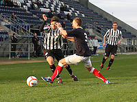 Ross Meechan takes on Kyle Turnbull watched by Graeme McGregor at the Falkirk v St Mirren  Scottish Football Association Youth Cup 4th Round match played at the Falkirk Stadium, Falkirk on 16.12.12.