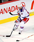 23 January 2010: New York Rangers' left wing forward and former Canadien Christopher Higgins controls the puck during a game against the Montreal Canadiens at the Bell Centre in Montreal, Quebec, Canada. The Canadiens shut out the Rangers 6-0. Mandatory Credit: Ed Wolfstein Photo