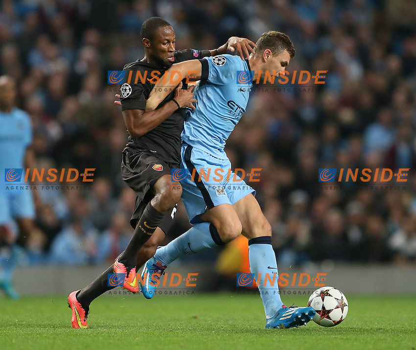 Seydou Keita of Roma challenges Edin Dzeko of Manchester City - UEFA Champions League group E - Manchester City vs Roma - Etihad Stadium - Manchester - England - 30th September 2014 - Picture Simon Bellis/Sportimage