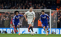 Zlatan Ibrahimovic of Paris Saint-Germain turns Willian (left) of Chelsea & Diego Costa of Chelsea during the UEFA Champions League Round of 16 2nd leg match between Chelsea and PSG at Stamford Bridge, London, England on 9 March 2016. Photo by Andy Rowland.