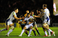 Horacio Agulla of Bath Rugby is held by Luke Wallace and Chris Robshaw of Harlequins
