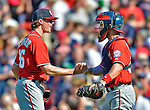 10 June 2012: Washington Nationals pitcher Tyler Clippard gets congratulated by catcher Jesus Flores after closing out the game against the Boston Red Sox at Fenway Park in Boston, MA. Harper scored the game winning run in the 9th inning as the Nationals defeated the Red Sox 4-3 to sweep their 3-game interleague series. Mandatory Credit: Ed Wolfstein Photo