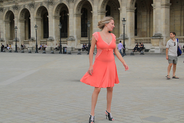 Woman posing in front of the Louvre Museum, Paris, France. .  John offers private photo tours in Denver, Boulder and throughout Colorado, USA.  Year-round. .  John offers private photo tours in Denver, Boulder and throughout Colorado. Year-round.