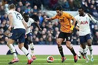 Raul Jimenez of Wolverhampton Wanderers dribbles through the Tottenham defence during Tottenham Hotspur vs Wolverhampton Wanderers, Premier League Football at Tottenham Hotspur Stadium on 1st March 2020