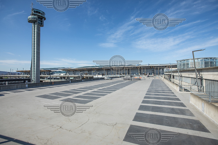 Empty parking by the main terminal. <br />  <br /> Norwegian authorites introduced measures to combat the Coronavirus (COVID-19)  leaving Gardermoen Airport, near the Norwegian capital Oslo, deserted. <br /> <br /> Restriction on public gatherings and travel have grounded most airplanes, and stopped nearly all domestic and foreign travel. <br /> <br />  Like most capitals, Oslo is usually busy on a Saturday night. But on the first weekend after Norwegian authorites introduced measures to combat the Coronavirus (COVID-19) the city was almost deserted. <br /> <br /> Restriction on public gatherings, closure of schhols, new rules for those serving food and drinks, and fear of further spread of the virus compelled most bars and restaurants to close. <br /> <br /> 28,5 million passangers used the airport in 2018, with the airline Norwegian flying the most people. At teh time of writing Norweigan is on the verge of bankruptcy, and hoping to get governemnt aid to surive the economic crisis caused by the corona virus.  <br /> <br /> <br /> ©Fredrik Naumann/Felix Features