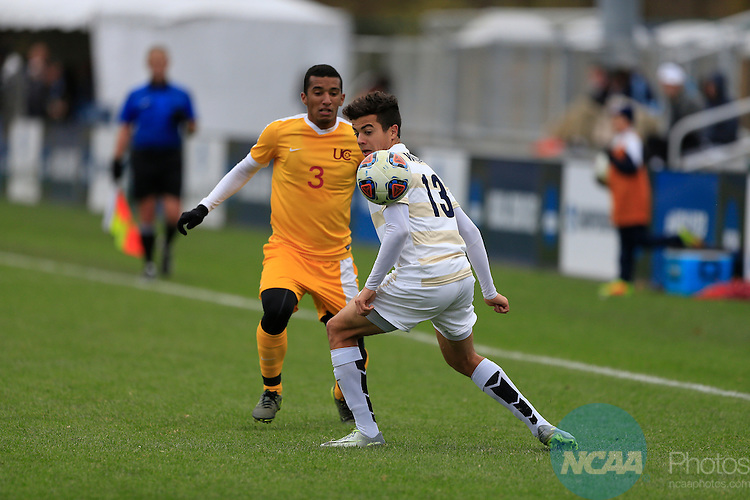 KANSAS CITY, MO - DECEMBER 03:  Vicente Munoz (13) of Wingate University and Bruno Oliviera (3) of the University of Charleston battle for the ball during the Division II Men's Soccer Championship held at Children's Mercy Victory Field at Swope Soccer Village on December 03, 2016 in Kansas City, Missouri. Wingate beat Charleston 2-0 to win the National Championship. (Photo by Jack Dempsey/NCAA Photos via Getty Images)
