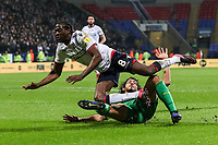 Bolton Wanderers' Clayton Donaldson goes down in a challenge with West Bromwich Albion's Ahmed Hegazy<br /> <br /> Photographer Andrew Kearns/CameraSport<br /> <br /> The EFL Sky Bet Championship - Bolton Wanderers v West Bromwich Albion - Monday 21st January 2019 - University of Bolton Stadium - Bolton<br /> <br /> World Copyright © 2019 CameraSport. All rights reserved. 43 Linden Ave. Countesthorpe. Leicester. England. LE8 5PG - Tel: +44 (0) 116 277 4147 - admin@camerasport.com - www.camerasport.com