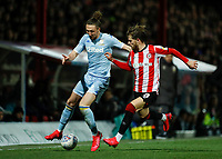 11th February 2020; Griffin Park, London, England; English Championship Football, Brentford FC versus Leeds United; Mathias Jensen of Brentford challenges Luke Ayling of Leeds United