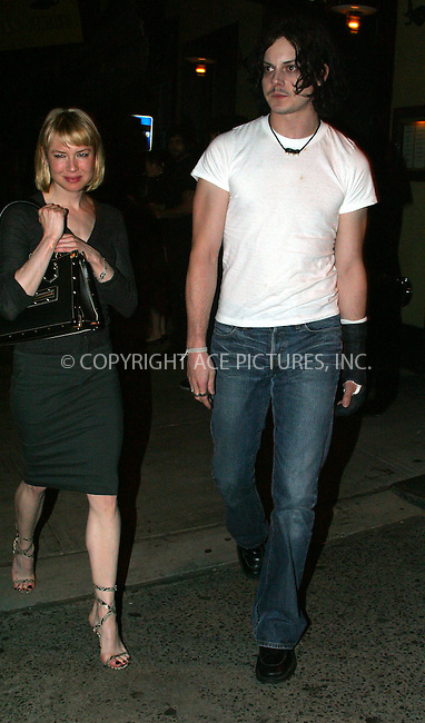 """Chicago"" star Renee Zellweger was all smiles when she stepped out with her new boyfriend, 'White Stripes' frontman Jack White. The happy couple was seen leaving their Downtown hotel separately, but later, after spending about 3 hours at Fiamma Restaurant in SoHo, they walked down the street together. Jack White wore a bandage on his left arm after fracturing his index finger in a car accident on July 9 in White's hometown of Detroit. Zellweger was in the car at the time of accident but was reportedly unhurt. New York, July 25, 2003. Please byline: NY Photo Press.   ..*PAY-PER-USE*      ....NY Photo Press:  ..phone (646) 267-6913;   ..e-mail: info@nyphotopress.com"