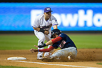 Mauricio Dubon (10) of the Salem Red Sox is tagged out by Gerson Montilla (17) of the Winston-Salem Dash as he slides into third base at BB&T Ballpark on April 15, 2016 in Winston-Salem, North Carolina.  The Red Sox defeated the Dash 3-2.  (Brian Westerholt/Four Seam Images)