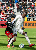 WASHINGTON, DC - FEBRUARY 29: Junior Moreno #5 of DC United defends against Kei Kamara #23 of the Colorado Rapids during a game between Colorado Rapids and D.C. United at Audi Field on February 29, 2020 in Washington, DC.