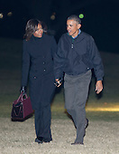 United States President Barack Obama and first lady Michelle Obama arrive on the South Lawn of the White House in Washington, D.C. in the early morning hours of Wednesday, January 28, 2015.  The President and first lady returned from a State Visit to India and a visit to Saudi Arabia.<br /> Credit: Ron Sachs / Pool via CNP