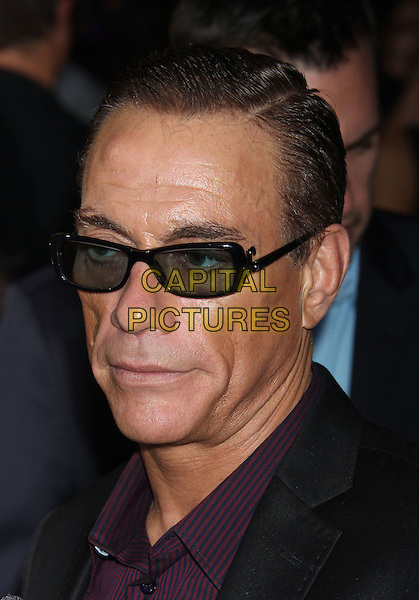 Jean-Claude Van Damme.'The Expendables 2' premiere held at The Grauman's Chinese Theatre, Hollywood, California, USA..15th August 2012.headshot portrait black suit purple shirt sunglasses shades  .CAP/ADM/RE.©Russ Elliot/AdMedia/Capital Pictures.