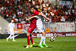 Helio Jose De Souza Goncalves of Hong Kong (L) fights for the ball with Mohammad Aldmeiri of Jordan (R) during the International Friendly match between Hong Kong and Jordan at Mongkok Stadium on June 7, 2017 in Hong Kong, China. (Photo by Power Sport Images/Getty Images)