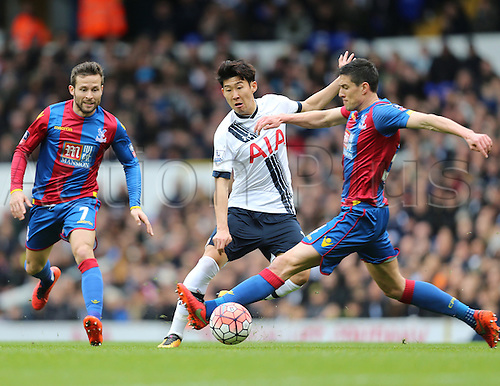 21.02.2016. White Hart Lane, London, England. Emirates FA Cup 5th Round. Tottenham Hotspur versus Crystal Palace. Son Heung-min  tackled by Martin Kelly
