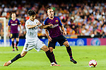 Arthur Melo of FC Barcelona (R) in action against Carlos Soler of Valencia CF (L) during their La Liga 2018-19 match between Valencia CF and FC Barcelona at Estadio de Mestalla on October 07 2018 in Valencia, Spain. Photo by Maria Jose Segovia Carmona / Power Sport Images