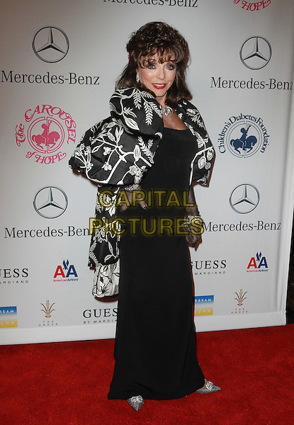 Joan Collins.26th Annual Carousel of Hope Gala held at the Beverly Hilton Hotel, Beverly Hills, California, USA..20th October 2012.full length hand on hip dress black white print jacket gloves .CAP/ADM/KB.©Kevan Brooks/AdMedia/Capital Pictures.