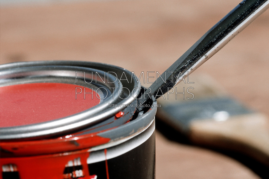 PRYING OPEN PAINT CAN<br /> A paint can is opened with a flat-head screwdriver, which is an example of a first-class lever.